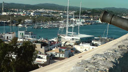 Europe Spain Balearic Ibiza Eivissa city 184 city wall, harbor and a cannon Footage
