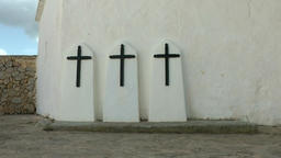 Europe Spain Balearic Ibiza towns and villages 192 christ crosses on churchyard Footage