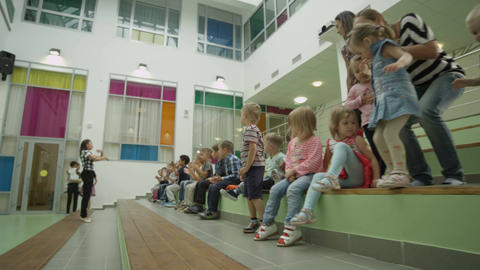 Children with Nursery-governesses Have Fun and Clap Hands Footage