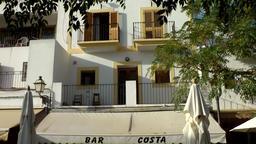 Europe Spain Balearic Ibiza village santa gertrudis 210 spanish ham restaurant Footage