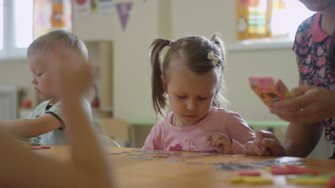 Nursery-governess Shows Paper Details to Little Girl Footage