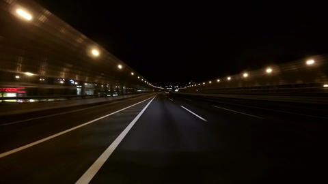 Street lights on the empty Tomei Expressway heading to Tokyo GIF