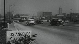 USA 1950s: Los Angeles City Limit Sign with Freeway Traffic Filmmaterial
