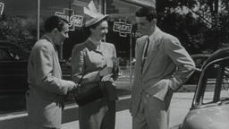 USA 1950s: Car Salesman with Young Couple Filmmaterial