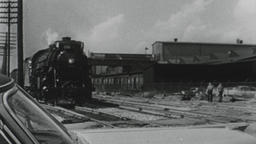 USA 1950s: Train Passes Waiting Car Stopped at Tracks Footage
