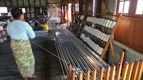 White silk thread on the weaving tool Footage