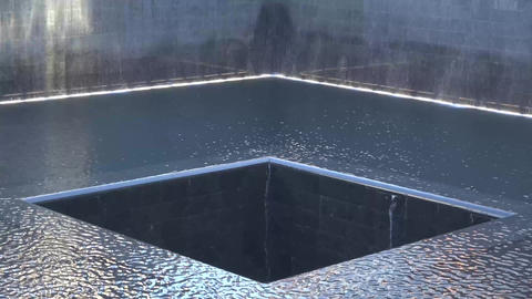 Manhattan twilight 9/11 memorial fountain panorama circa New York, USA. Water fa Footage