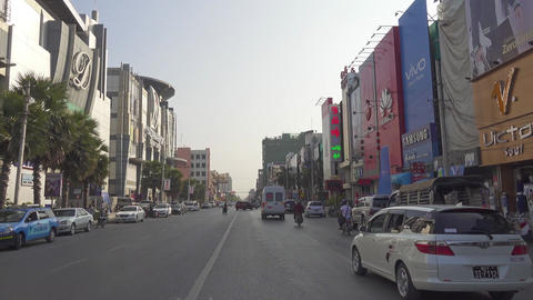 View from car to streets of Mandalay city Footage