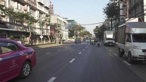 Cars, taxi and tuk-tuk on the streets of Bangkok Footage