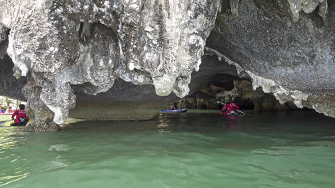 Kayaking between the rocks and caves Footage