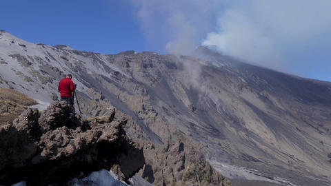 Photographer Taking Pictures And Shooting Video Of Mount Etna Volcano Footage