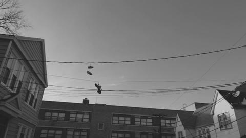 Old School Shoes On A Wire Footage