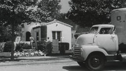 USA 1950s: Residential Moving Company Unloads Truck Footage
