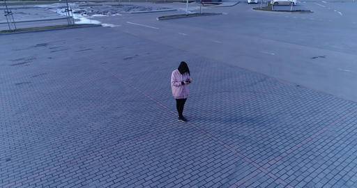 Woman With Phone In The Parking Footage