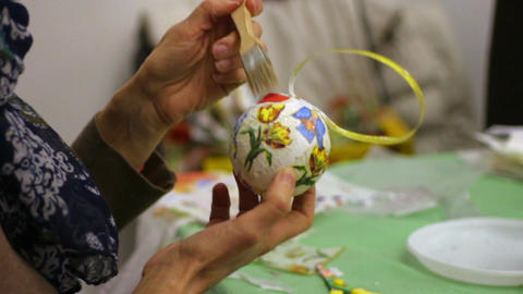Woman decorating Christmas toy at art and craft lesson, creative hobby Live Action