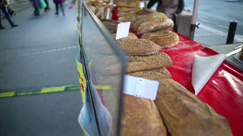 Freshly baked bread lying on the showcase at street market, crisis, high prices Footage