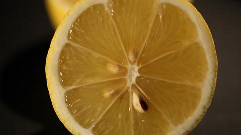 Fresh cut lemon closeup, juicy ingredient for lemonade or cocktail, culinary Footage