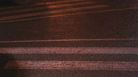 Pedestrians crossing street, cars stuck in traffic jam, night urban life Footage