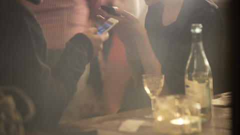 Busy people using smartphones at party, replacing communication with gadgets Live Action