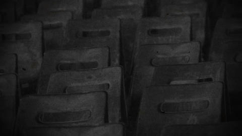 Desolate city, abandoned cinema hall with empty chairs captured on old filmstrip Footage