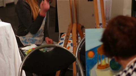 People painting pictures during masterclass at art school, interesting hobby Footage