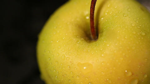 Organic green apple covered in water drops, refreshing juicy fruit, healthy diet Footage