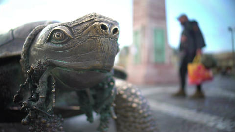 Close-up of turtle sculpture holding bunch of grapes in mouth, Bordeaux, France Footage