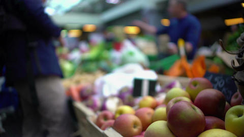 Man buying fruit at local market, healthy lifestyle and food, view on apples Footage