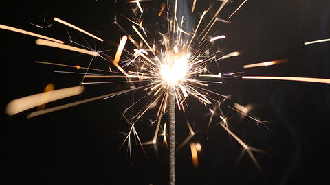 Sparkling bengal light burning in darkness, happy atmosphere at New Year party Footage