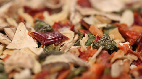 Close up of dried herb and spice blend rotating, variety of seasoning at market Footage