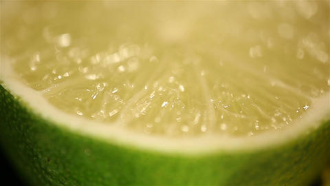 Juicy lime halves rotating on stand, macro. Fresh exotic... Stock Video Footage