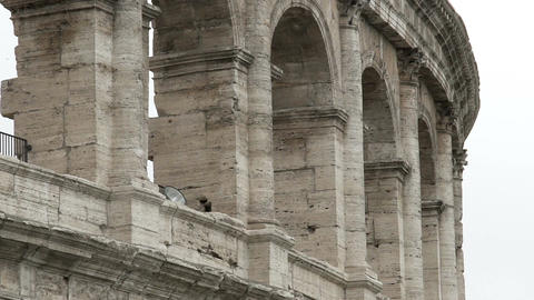 Antique gray columns of amphitheater Coliseum, historic building in Rome, Italy Live Action