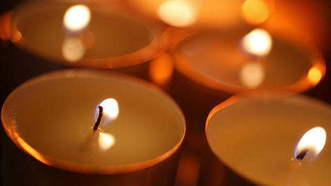 Vulnerable candle flames shaking in strong wind, last hope striving to survive Live Action