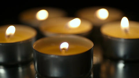 Burning candles in church close-up, religion and faith, praying for soul Footage