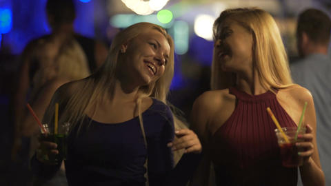 Happy female friends enjoying party on dance floor, clanging cocktail glasses Footage
