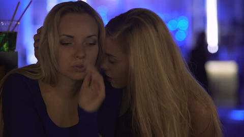 Drunk young ladies hugging and having heart talk at nightclub party, friendship Footage