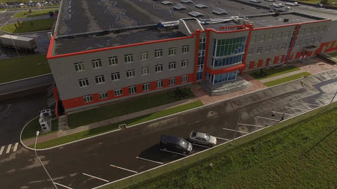 Aerial View Plant Building with White and Orange Facade Footage