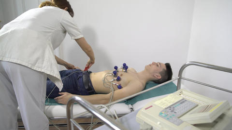 The patient makes electrocardiogram during stress test Footage