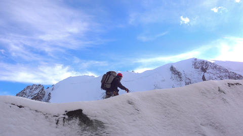 Alpinist Hiking In Snowy Mountains Footage