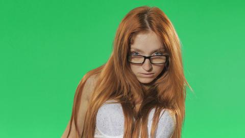 Red girl slowly undresses,green screen, alpha Filmmaterial