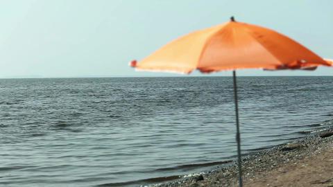 seascape parasol on empty beach Footage