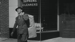 4K USA 1950s: Man Picks Up Dry Cleaning in Small Town Footage