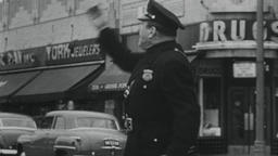 USA 1950s: Small Town Cop Directs Traffic and Confronts Motorist Footage