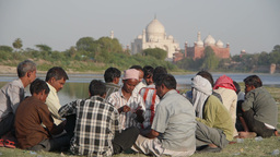 Taj Mahal From A Distance With People Playing Cards,Agra,India stock footage