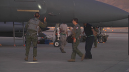 Aircrew members perform a preflight inspection on an F-15E before takeoff Footage