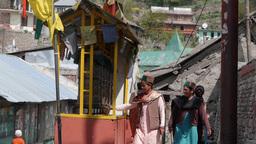 Kalpa central prayer wheels with people spinning it,Kalpa,India Footage