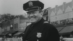 USA 1950s: Happy Small Town Cop Directs Traffic Footage