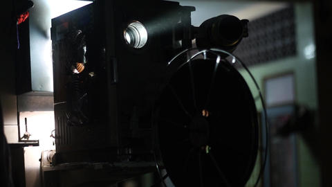 Old film projector playing in the countryside in Asian Live Action