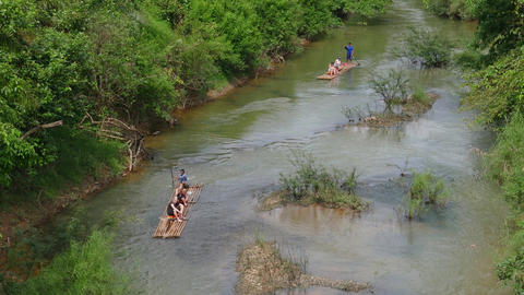 Tourists rafting along the river on bamboo rafts Footage