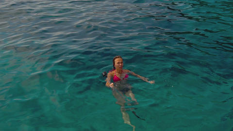 Relaxed woman swims in sea Footage